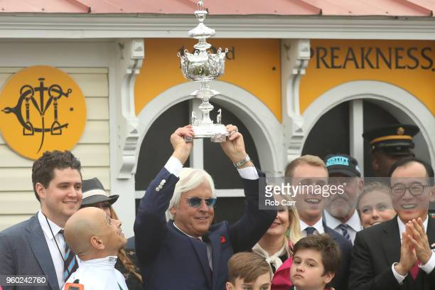 Trainer of Justify Bob Baffert celebrates after jockey Mike Smith won the 143rd running of the Preakness Stakes at Pimlico Race Course on May 19,...