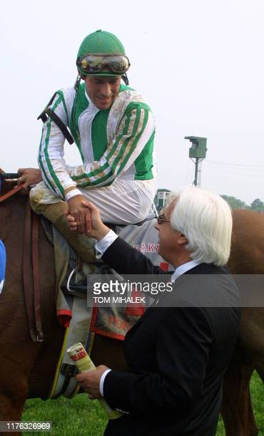 Trainer of Point Given Bob Baffert congratulates jockey Gary Stevens after Point Given won the 126th running of the Preakness Stakes at Pimlico Race...