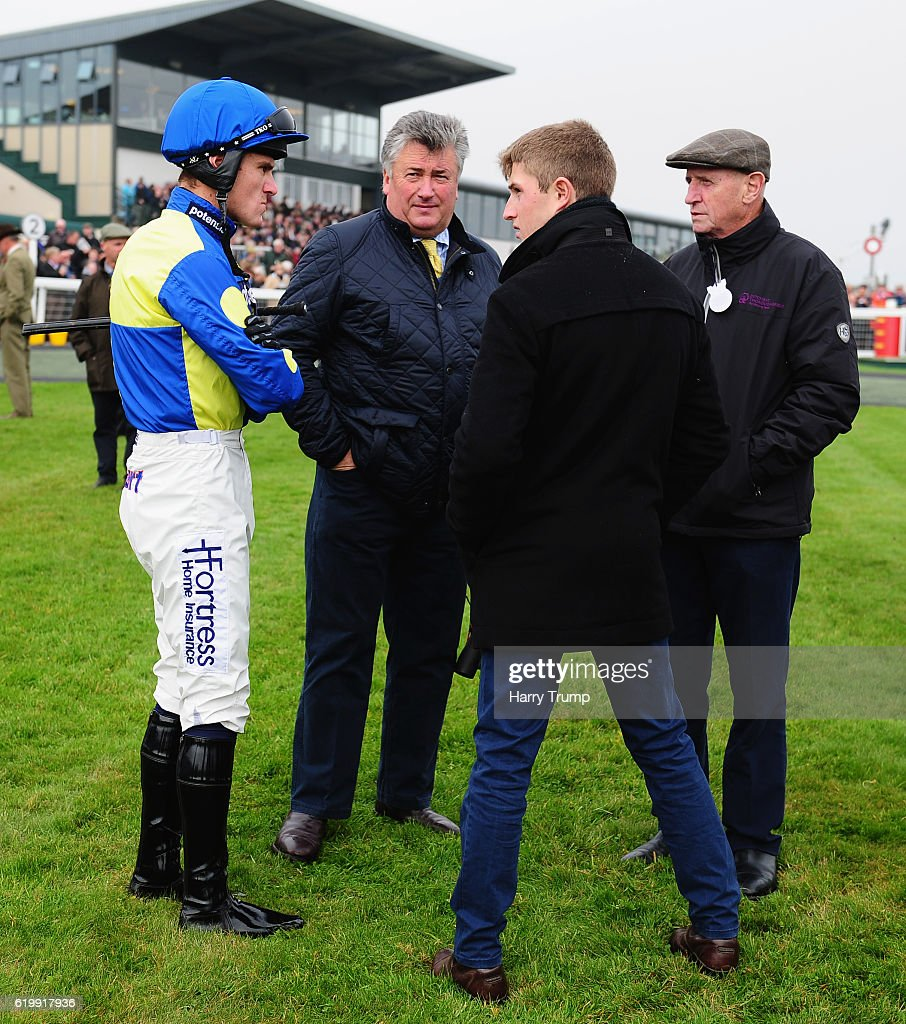 Trainer Paul Nicholls(C) chats to Jockey Nick Scholfield (L), Assistant Trainer Harry Derham (C) and connections at Exeter Racecourse on November 1, 2016 in Exeter, England.