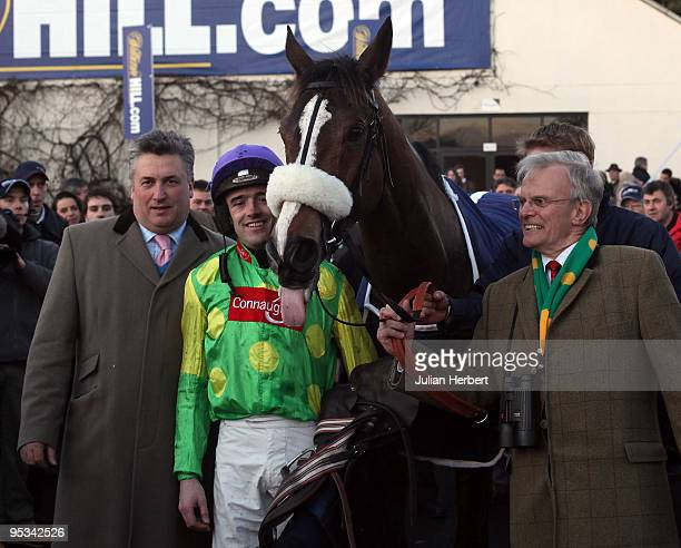 Trainer Paul Nicholls, jockey Ruby Walsh and owner Clive Smith pose after Kauto Star won The William Hill King George VI Steeple Chase Race run at...
