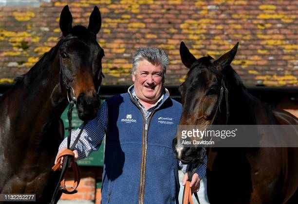 Trainer Paul Nicholls poses with Clan Des Obeaux and Frodon at Manor Farm Stables on February 26 2019 in Ditcheat Somerset