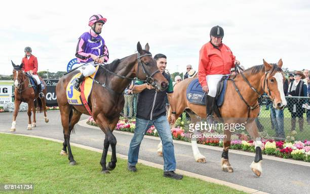 Trainer Peter Gelagotis leads Moss 'n' Dale ridden by Anthony Darmanin back to scale after winning the Mercedes Benz Handicap at Warrnambool...