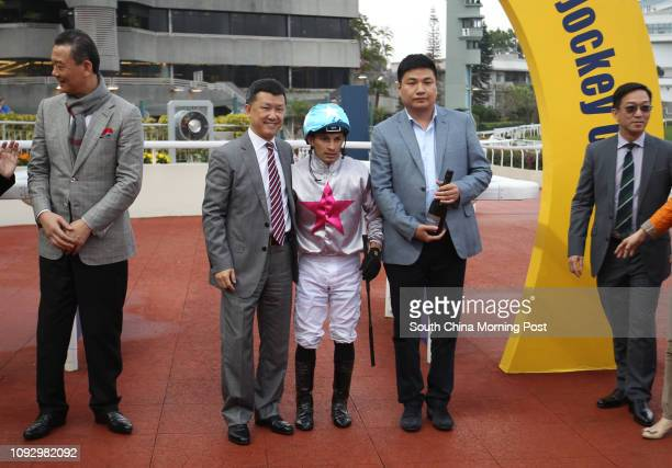 Trainer Peter Ho Leung, jockey Silvestre de Sousa and Chua Hwa Por, owner of Limitless celebrate the class 2 win over 1400m at the Sha Tin...