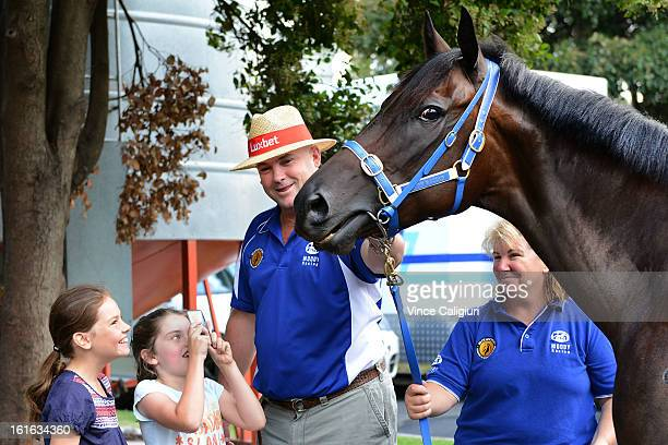 Trainer Peter Moody gives Matilda Garvey and Mia Allen a close look at Black Caviar at this morning's media call at Caulfield Racecourse on February...