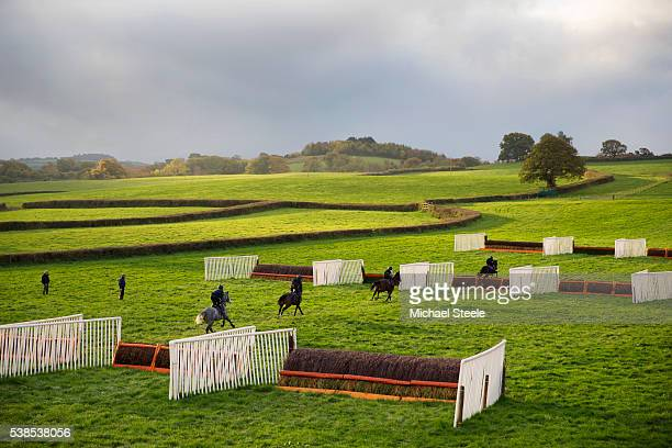 Trainer Philip and Assistant Trainer Johnson White look on during a schooling session at Sandhill Racing Stables on October 26 2015 in Minehead...