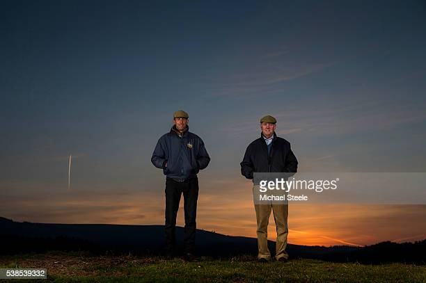 Trainer Philip Hobbs alongside assistant trainer Johnson White at Sandhill Racing Stables on March 21 2016 in Minehead England Sandhill Racing...