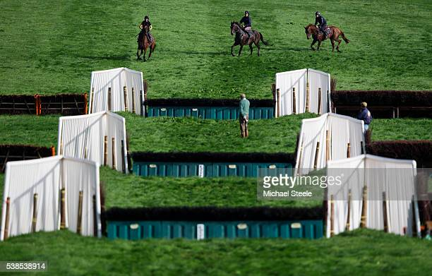 Trainer Philip Hobbs and assistant trainer Johnson White look on during a schooling session at Sandhill Racing Stables on September 23 2015 in...