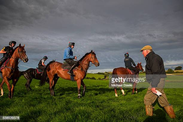 Trainer Philip Hobbs checks on Tom Cheesman and Stefan Kirwan during a schooling session on the lower ground at Sandhill Racing Stables on September...