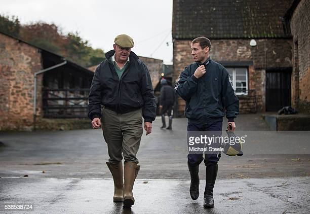 Trainer Philip Hobbs in conversation with Richard Johnson after second lot at Sandhill Racing Stables on November 4 2015 in Minehead England Sandhill...