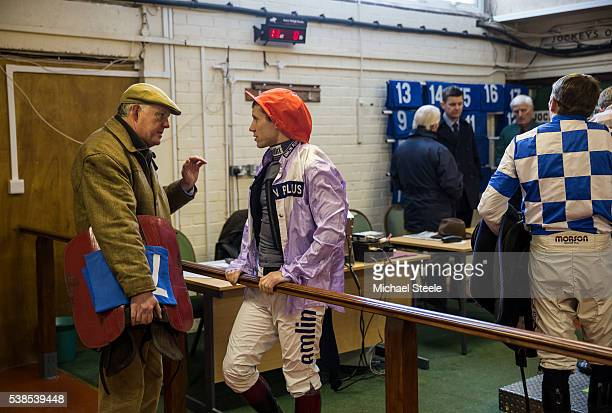 Trainer Philip Hobbs issues final instructions to Richard Johnson in the weighing room at Taunton Racecourse on January 13 2016 in Taunton England...