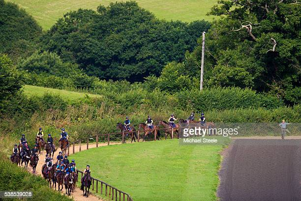 Trainer Philip Hobbs looks on as the second lot head back to the yard at Sandhill Racing Stables on August 3 2015 in Minehead England Sandhill Racing...