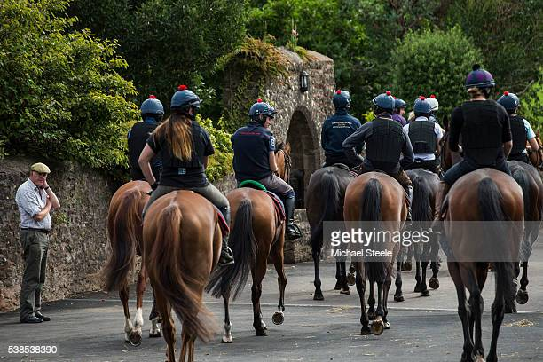 Trainer Philip Hobbs looks on as the second lot head out at Sandhill Racing Stables on September 4 2015 in Minehead England Sandhill Racing Stables...