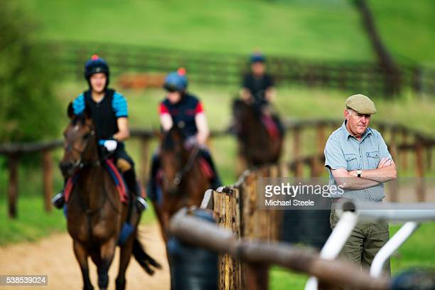 Trainer Philip Hobbs looks on during first lot at Sandhill Racing Stables on August 3 2015 in Minehead England Sandhill Racing Stables set in 500...
