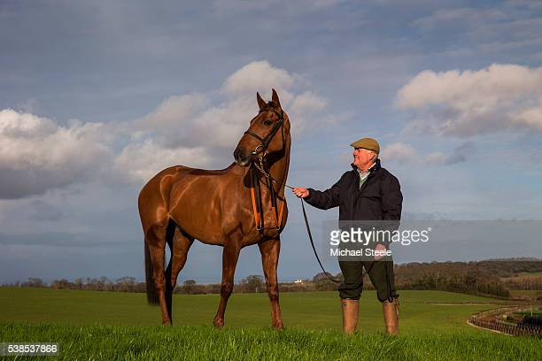 Trainer Philip Hobbs poses with Wishfull Thinking on January 8 2016 in Minehead England Sandhill Racing Stables set in 500 hundred acres of farmland...