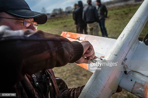 Trainer repairs drone used for training Ukrainian soldiers to control unmanned aerial vehicle in the field at Training Center of Ukrainian Military...