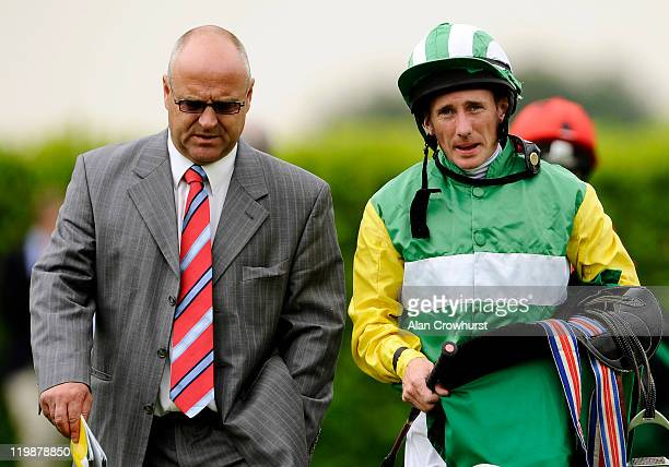 Trainer Richard Fahey with Paul Hanagan at Goodwood racecourse on July 26 2011 in Chichester England