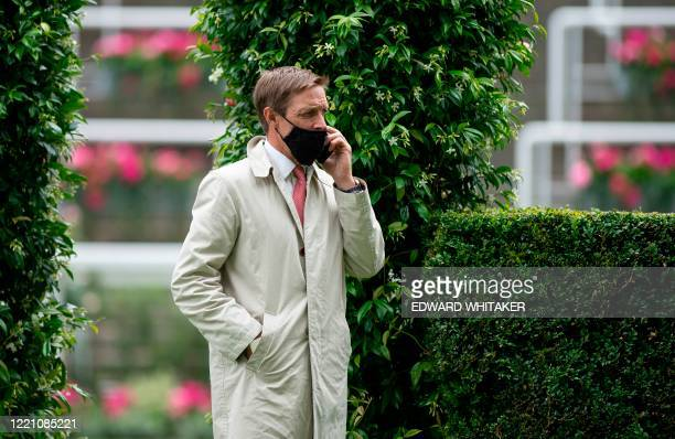 Trainer Richard Hughes is seen on day four of the Royal Ascot horse racing meet, in Ascot, west of London, on June 19 which is taking place behind...