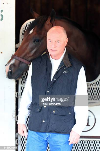 Trainer Richard Mandella looks on with Omaha Beach after Omaha Beach was scratched the 145th running of the Kentucky Derby at Churchill Downs due to...
