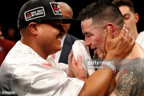 Trainer Robert Garcia embraces Brandon Rios after his loss to Danny Garcia in a welterweight bout at the Mandalay Bay Events Center on February 17,...