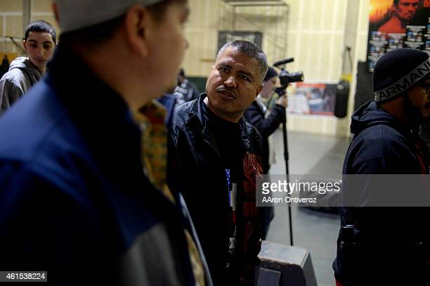 Trainer Robert Garcia speaks during media day. Media day for Mike Alvarado and Brandon Rios in preparation for their third fight on Wednesday,...