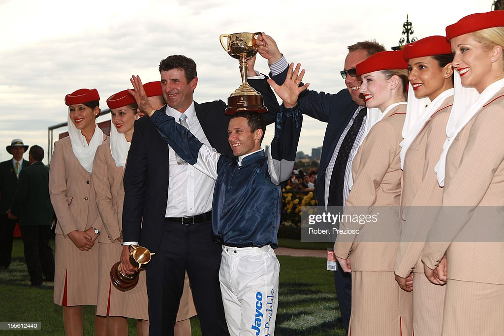 Trainer Robert Hickmott, jockey Brett Prebble and winning owner Nick Williams, pose with the Melbourne Cup trophy after Green Moon won the Emirates Melbourne Cup during 2012 Melbourne Cup Day at Flemington Racecourse on November 6, 2012 in Melbourne, Australia.