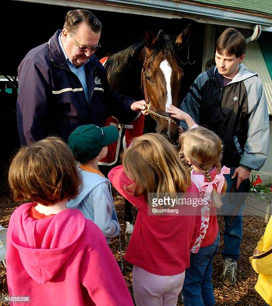 Trainer Robert Holthus top left show a group of young children his horse Loramateael a two yearold filly after her early morning workout at Churchill...