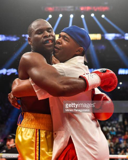 Trainer SugarHill Steward hugs Adonis Stevenson for his victory against Andrzej Fonfara in the second round during the WBC light heavyweight world...
