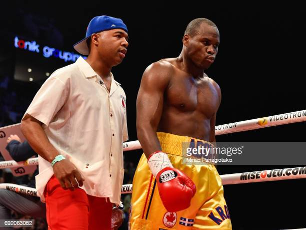 Trainer SugarHill Steward walks with Adonis Stevenson towards their corner after the first round during the WBC light heavyweight world championship...