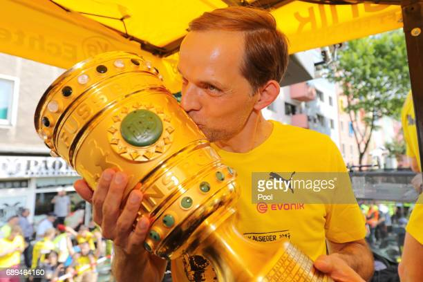 Trainer Thomas Tuchel of Borussia Dortmund lifts the DFB Cup trophy as the team celebrates during a winner's parade at Borsigplatz on May 28 2017 in...