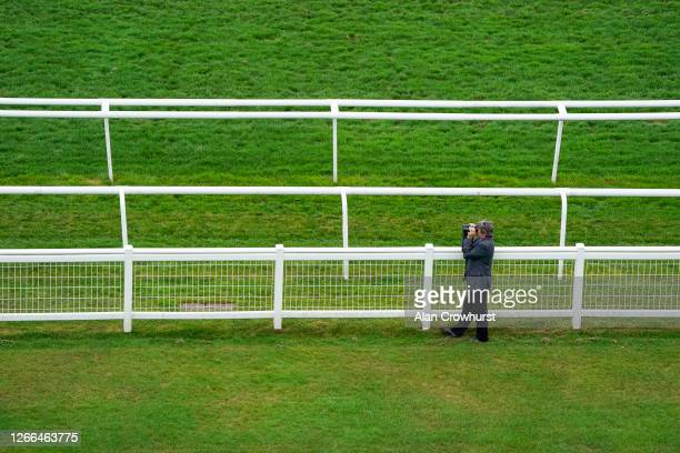 Trainer Tony Carroll watches the action from the rails at Newbury Racecourse on August 15 2020 in Newbury England Owners are allowed to attend if...