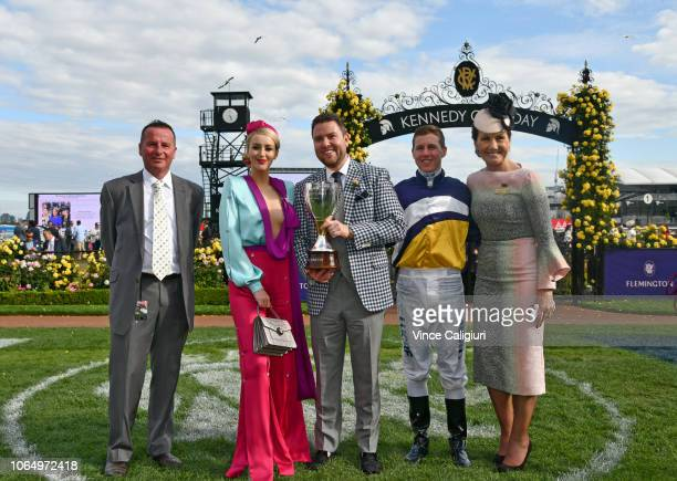 Trainer Trainer Matthew Ellerton Kennedy sponsors Damian Lane and VRC Chairman Amanda Elliott pose with Kennedy Oaks trophy after Aristia won in Race...