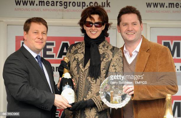 Trainer Venetia Williams and Owner Paul Beck collect the trophy after winning the Mears Group Silver Trophy Chase with their horse Stan at Cheltenham...
