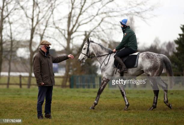 Trainer Willie Mullins on the gallops ahead of Day Two of the Cheltenham Festival at Cheltenham Racecourse, in Cheltenham, England on March 17, 2021....