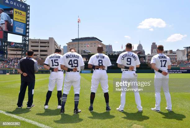 Trainer Yousef Zamat Mikie Mahtook Dixon Machado Justin Upton Nicholas Castellanos and Andrew Romine of the Detroit Tigers stand together during the...