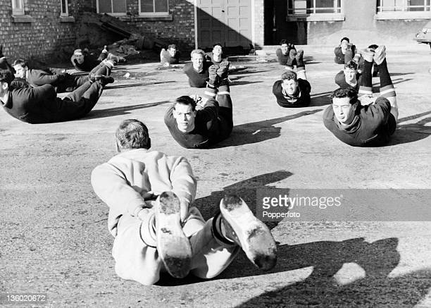 Trainercoach Jack Crompton leads a Manchester United training session in Manchester circa April 1958