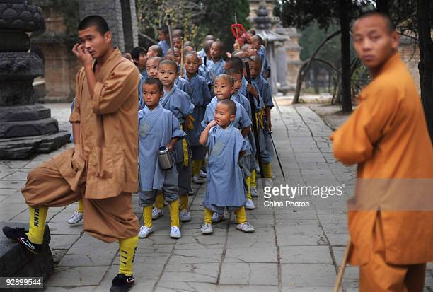 Trainers and boys from Shaolin Kung Fu Training Base rest at the Shaolin Temple on the Songshan Mountain on October 30 2009 in Dengfeng of Henan...