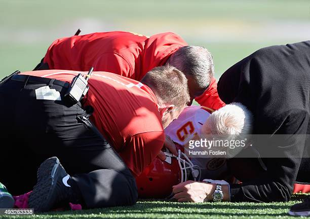 Trainers check on Jeremy Maclin of the Kansas City Chiefs after an injury during the fourth quarter of the game on October 18 2015 at TCF Bank...