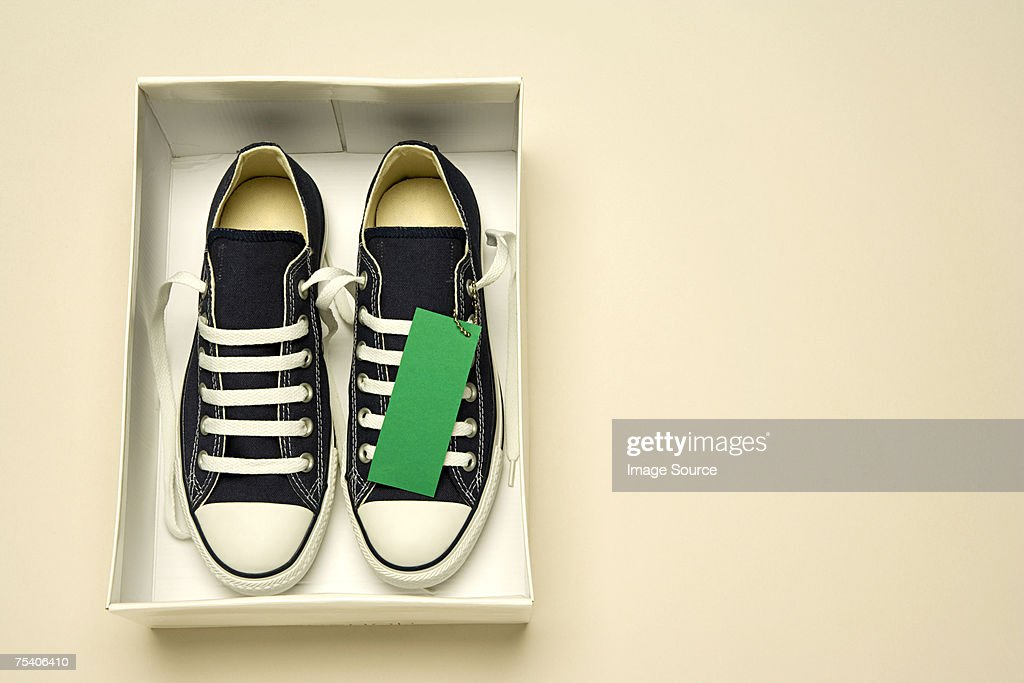 Trainers in shoe box : Stock Photo