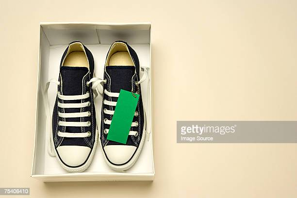 Trainers in shoe box