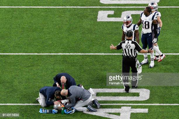 Trainers look over Brandin Cooks of the New England Patriots after a hit against the Philadelphia Eagles during the second quarter in Super Bowl LII...