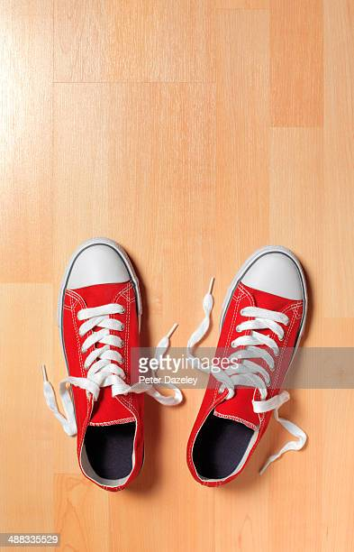 trainers on wooden floor - beige shoe stock pictures, royalty-free photos & images