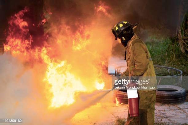 training and fire drill to the employee in the factory. - fire stock pictures, royalty-free photos & images