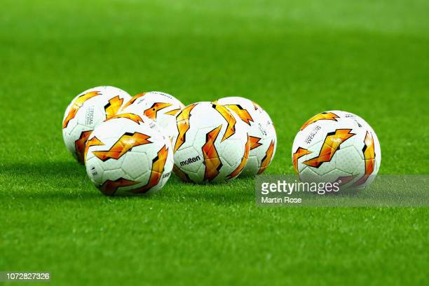 Training balls are seen on the pitch before the UEFA Europa League Group B match between RB Leipzig and Rosenborg at Red Bull Arena on December 13...