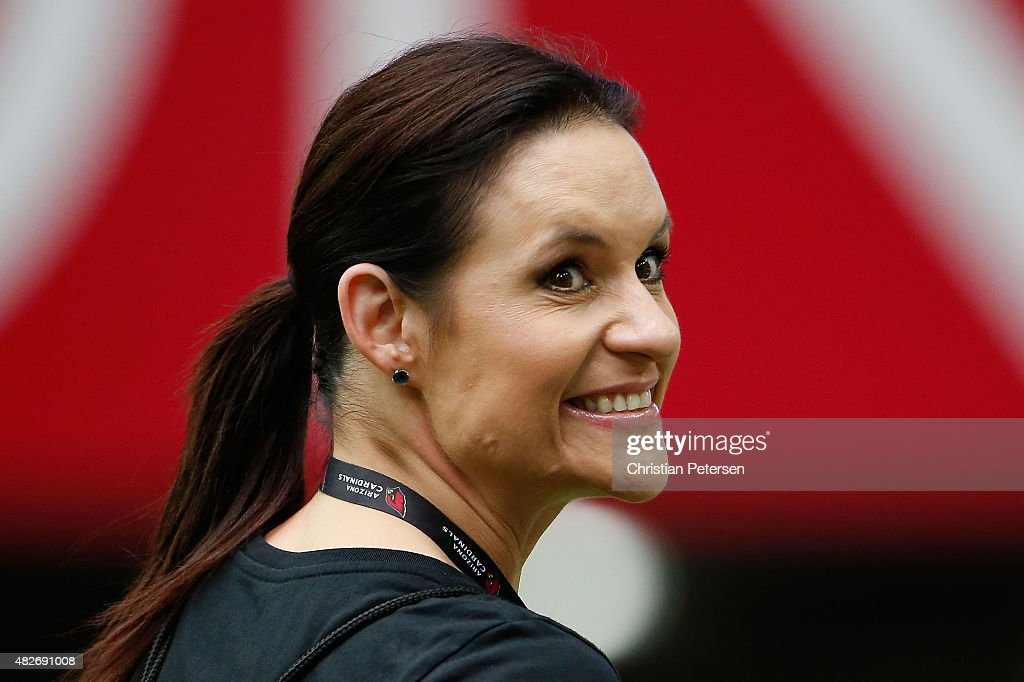 Training camp coach Jen Welter of the Arizona Cardinals smiles to fans during the team training camp at University of Phoenix Stadium on August 1, 2015 in Glendale, Arizona.