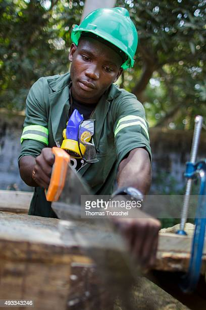 Training for carpenters at the vocational school Young Africa A Trainee sawing a piece of wood on September 29 2015 in Beira Mozambique