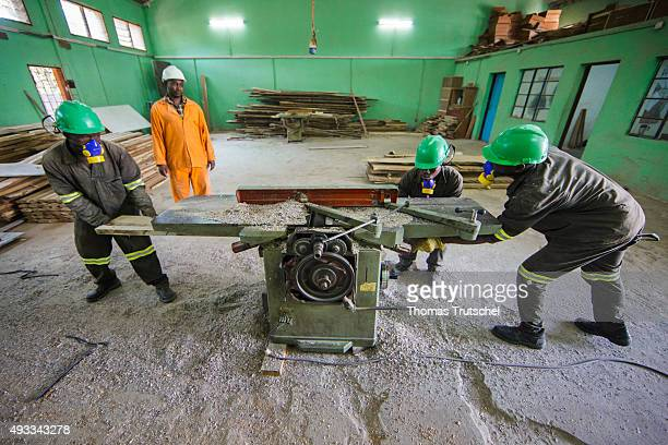 Training for carpenters at the vocational school Young Africa Apprentices work in the wood workshop on September 29 2015 in Beira Mozambique