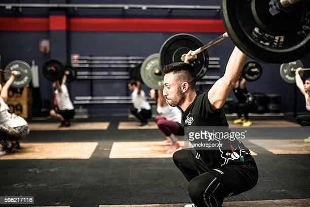 training gym class weightlifting on a gym la mole gym - crossfit stock pictures, royalty-free photos & images