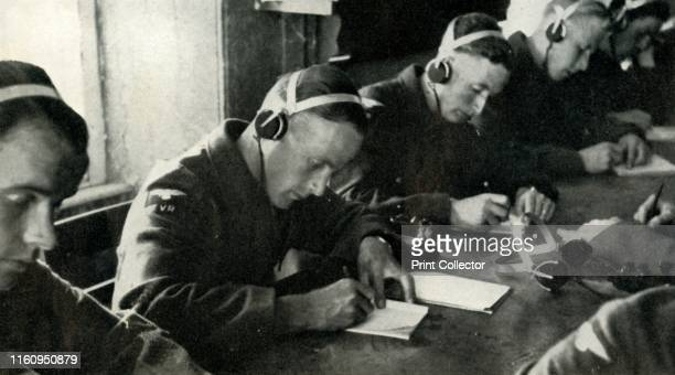 Training in telecommunications 1941 British RAF personnel in the classroom during the Second World War 'Class workin properly equipped rooms is used...