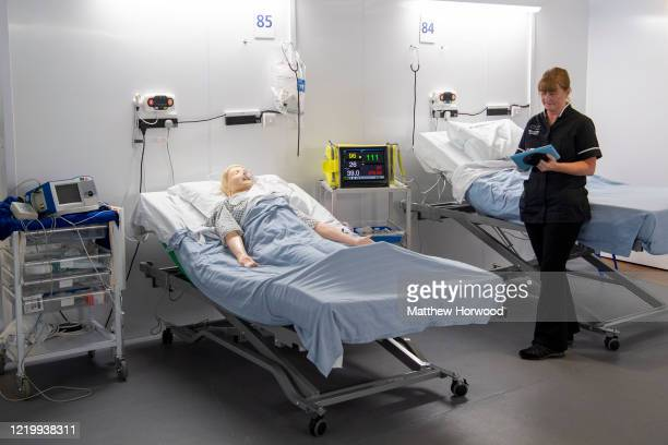 Training manager stands near a medical training mannequin which can be controlled using a computer on a ward at the new Dragon's Heart Hospital on...