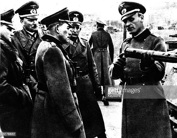 A training officer explaining to General Heinz Guderian whom the Germans call 'Father of the Panzerwaffe' details about a certain type of shell used...